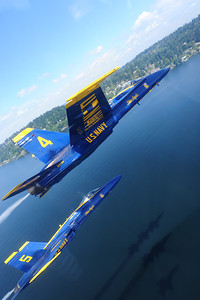 120802-N-DI587-1245 SEATTLE (August 2, 2012) U.S. Navy Flight Demonstration Squadron, the Blue Angels, pilots fly over Lake Washington during a practice demonstration August 2. The Blue Angels performed at Seafair as part of the 2012 air show season. (U.S. Navy photo by Mass Communication Specialist 1st Class Rachel McMarr/Released)