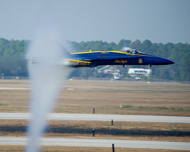 121103-N-LD780-101 PENSACOLA, Fla. (Nov. 3, 2012) U.S. Navy Flight Demonstration Squadron, the Blue Angels, Lt. Cmdr. C. J. Simonson, lead solo pilot, flies a sneak pass at nearly the speed of sound, 50 feet over the runway at the Pensacola Home Show at Naval Air Station Pensacola, Fla., Nov. 3. (U.S. Navy photo by Mass Communication Specialist 1st Class Eric Rowley/Released)
