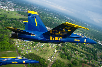 120330-N-BA418-039 TUSCALOOSA, Ala. (March 30, 2012) Capt. Greg McWherter, commanding officer and flight leader for the U.S. Navy flight demonstration squadron, the Blue Angels, leads a formation of F/A-18 Hornets during the Tuscaloosa Regional Air Show 2012. The Tuscaloosa Regional Air Show was the fourth show site of the squadron's 2012 season. (U.S. Navy photo by Mass Communication Specialist 2nd Class Andrew Johnson/Released)