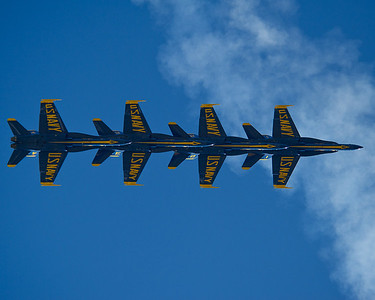 120909-N-LD780-747 LITTLE ROCK, Ark. (Sept. 9, 2012) U.S. Navy Flight Demonstration Squadron, the Blue Angels, diamond formation set up for the Vertical Break maneuver in a trail formation over the crowd during a flight demonstration at the Air Power Arkansas 2012 air show at Little Rock Air Force Base, Ark., Sept. 9. (U.S. Navy photo by Mass Communication Specialist 1st Class Eric Rowley/Released)