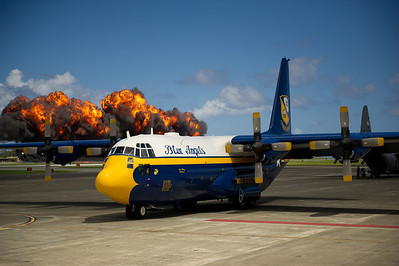 """120929-N-BA418-023 KANEOHE BAY, Hawaii (Sept. 29, 2012) A """"wall of fire"""" explodes behind U.S. Navy Flight Demonstration Squadron, the Blue Angels, C-130, affectionately known as Fat Albert, at Marine Corps Air Station Kaneohe Bay, Hawaii. The Blue Angels performed at the Kaneohe Bay Air Show, Hawaii, as part of the 2012 air show season and in celebration of the Centennial of Marine Corps Aviation. (U.S. Navy photo by Mass Communication Specialist 2nd Class Andrew Johnson/Released)"""