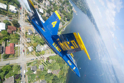 120802-N-DI587-0578 SEATTLE (August 2, 2012) U.S. Navy Flight Demonstration Squadron, the Blue Angels, Left Wing Pilot Marine Corps Capt. Brandon Cordill flies over Lake Washington during a practice demonstration August 2. The Blue Angels performed at Seafair as part of the 2012 air show season. (U.S. Navy photo by Mass Communication Specialist 1st Class Rachel McMarr/Released)