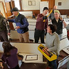 Clearing the pews at the East Blue Hill Community House on Saturday, April 6, 2013.