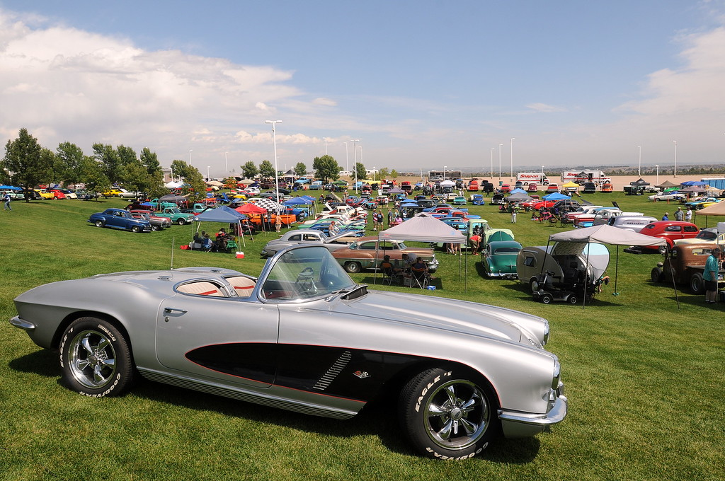 . A 1962 Corvette Stingray sits at the top of a field filled with classic cars at the 35th annual Blue Light Special car show put on at The Ranch in Loveland by the Blue Knights Car Club. (Photo by Craig Young / Loveland Reporter-Herald)