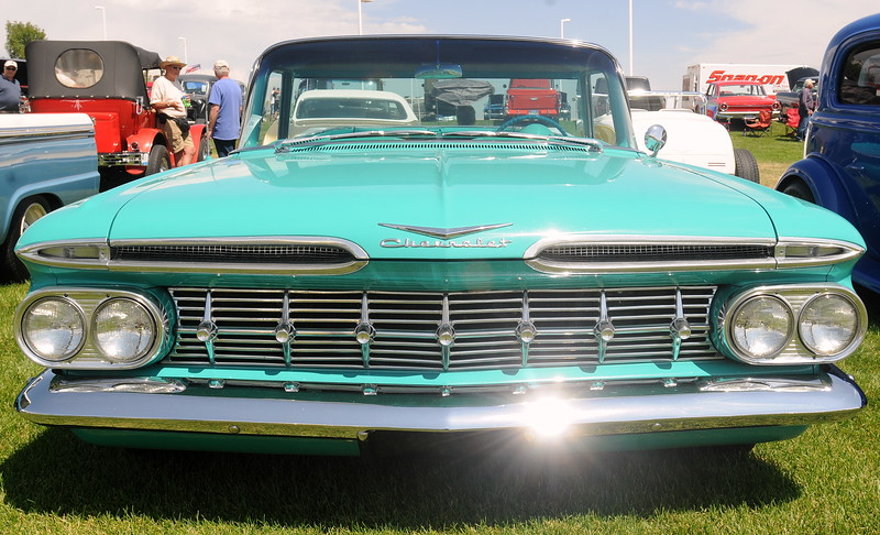 The sun glints off the polished chrome bumper of a 1959 Chevrolet El Camino on display at The Ranch in Loveland during the 35th annual Blue Light Special car show put on by the Road Knights Car Club of Loveland. (Photo by Craig Young / Loveland Reporter-Herald)