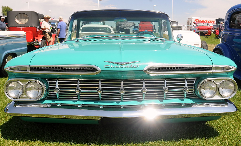 . The sun glints off the polished chrome bumper of a 1959 Chevrolet El Camino on display at The Ranch in Loveland during the 35th annual Blue Light Special car show put on by the Road Knights Car Club of Loveland. (Photo by Craig Young / Loveland Reporter-Herald)