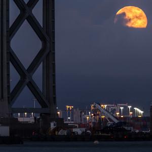 2014-07-12-moon-full-rising-bridge-san-francisco-oakland-bay-bridge- moon-under-deck-support-2
