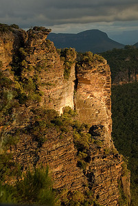 Part of the rocky escarpment at Cahills Point by late afternoon light - Katoomba, Blue Mountains, New South Wales, Australia