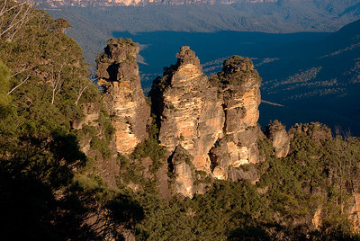 The Three Sisters, a famous rock formation in the Blue Mountains of New South Wales, Australia, as seen by late afternoon light in early autumn