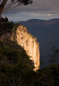Cyclorama Point, the site of a truly massive landslide in 1931 - Katoomba, Blue Mountains, New South Wales, Australia. This lighting is a direct beam of late afternoon sunlight through some dark stormclouds.