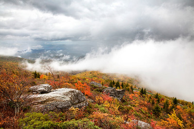 Looking down on the Blue Ridge Parkway and autumn storm clouds from the Rough Ridge Hiking trail.