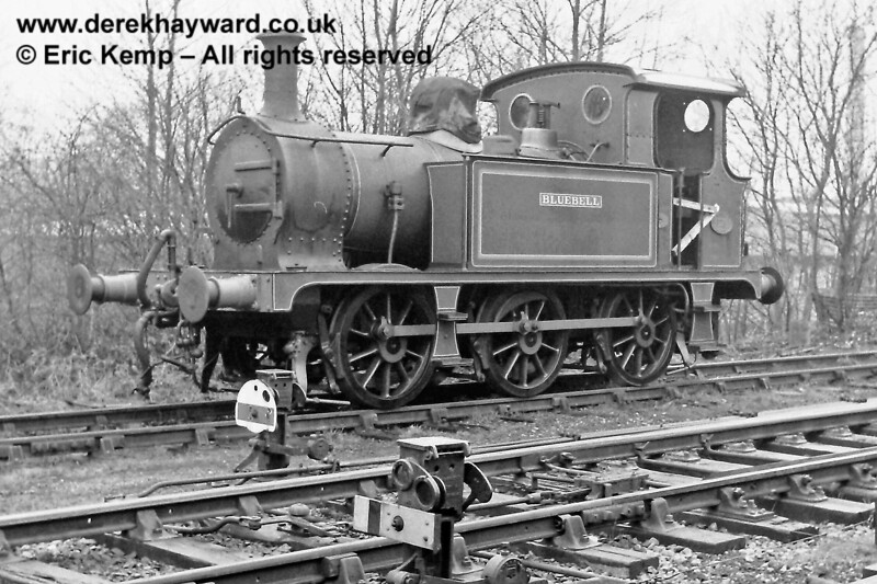 Bluebell before it had tankside crests. 16.03.1969  In the foreground the picture catches a permissive shunt signal, yellow with black stripe. It allowed a driver to pass the signal except when going out to the main line. It was commonly found at the exit from yards or sidings, allowing shunting to take place within the yard without the signalman being involved.  This example is a miniature arm but the disc version was more common.  Such signals are no longer used on the Bluebell Railway.