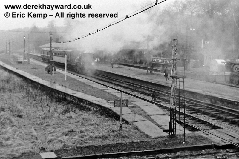 Horsted Keynes on 16.03.1969.  27 is in there somewhere!  No canopy on Platform 1 & 2 in those days; indeed no track in Platform 1.  The conductor rail has vanished and the arm has been removed from the Platform 2 Down starting signal.  The lattice post is now in use for the Outer Home signal at Sheffield Park.