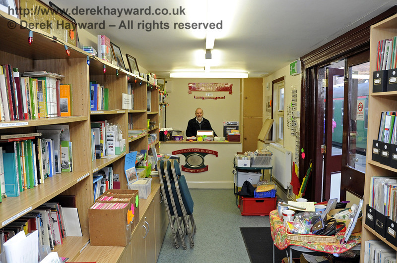 The interior of the Bulleid Bookshop on Platform 2 at Sheffield Park with David Foale (Finance Director) behind the counter.  10.12.2011  3343