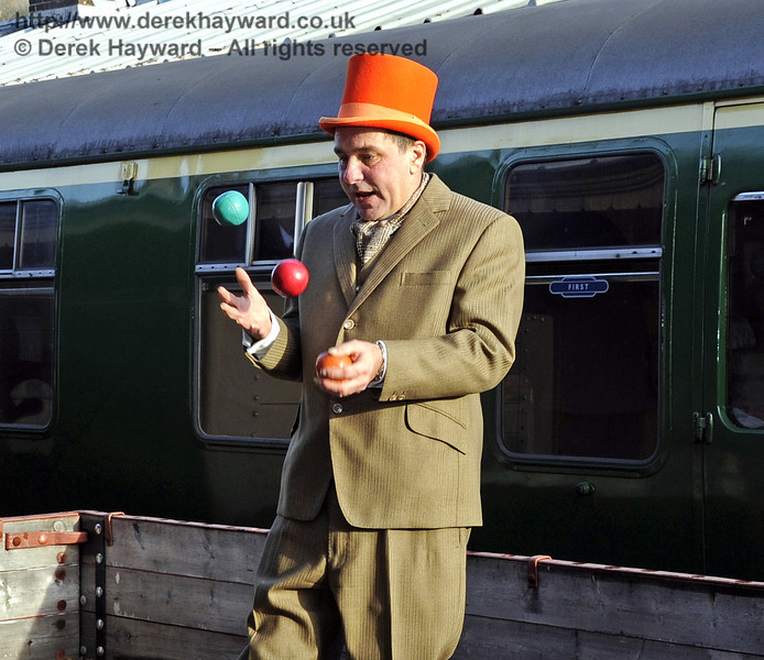 We must recruit this man at once; he can multi-task.  He can keep several balls in the air whilst aboard a goods train.  Horsted Keynes 10.12.2011  3248