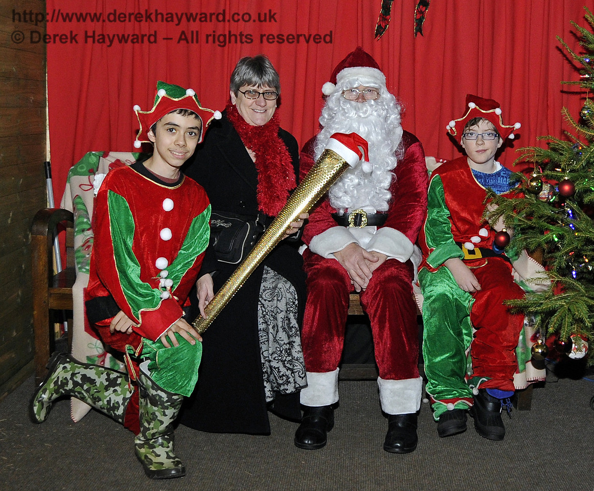 Santa and his Elves met Olympic Torch bearer Kate Steer at Horsted Keynes on 8 December 2012.  Kate carried the torch in Eastbourne on 17 July 2012.  6015