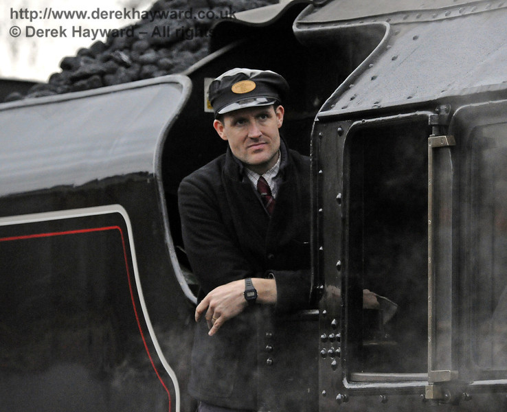 A crew member on board 45231 at Sheffield Park.  14.12.2013  8512