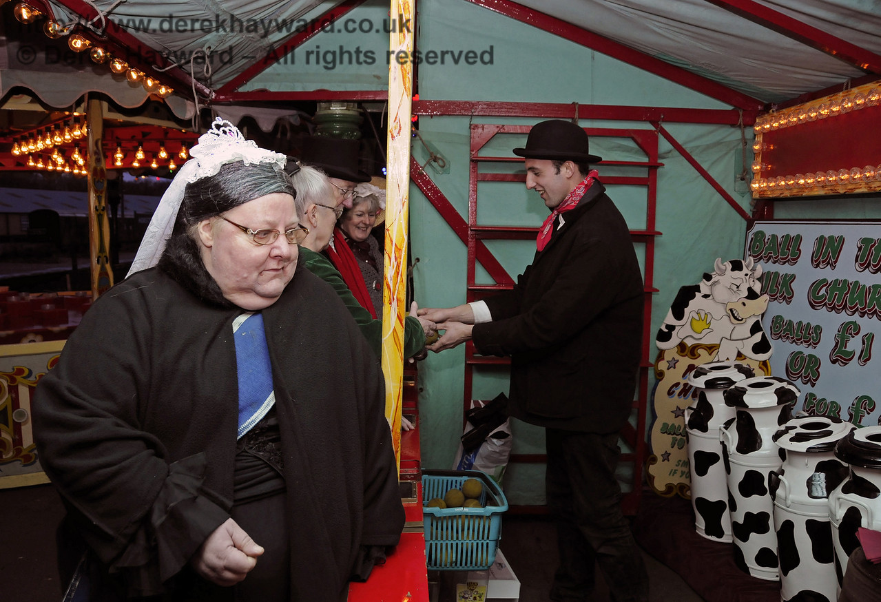 The railway was honoured by a visit from Queen Victoria, and apparently she WAS amused as she sampled the sideshows.  Horsted Keynes 20.12.2013  9942