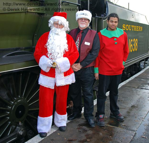 Santa, an elf, and a gentleman wearing a Bah Humbug hat.... Shocking! Kingscote 06.12.2009