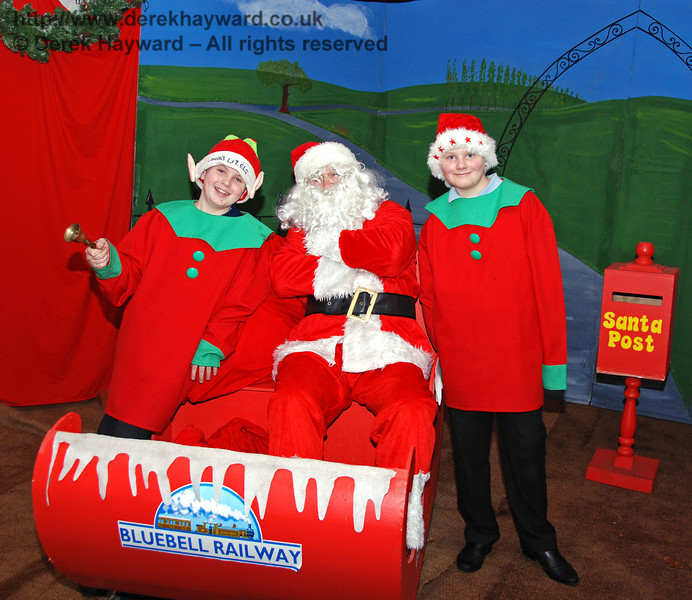Santa poses with some of his elves. Kingscote 05.12.2009