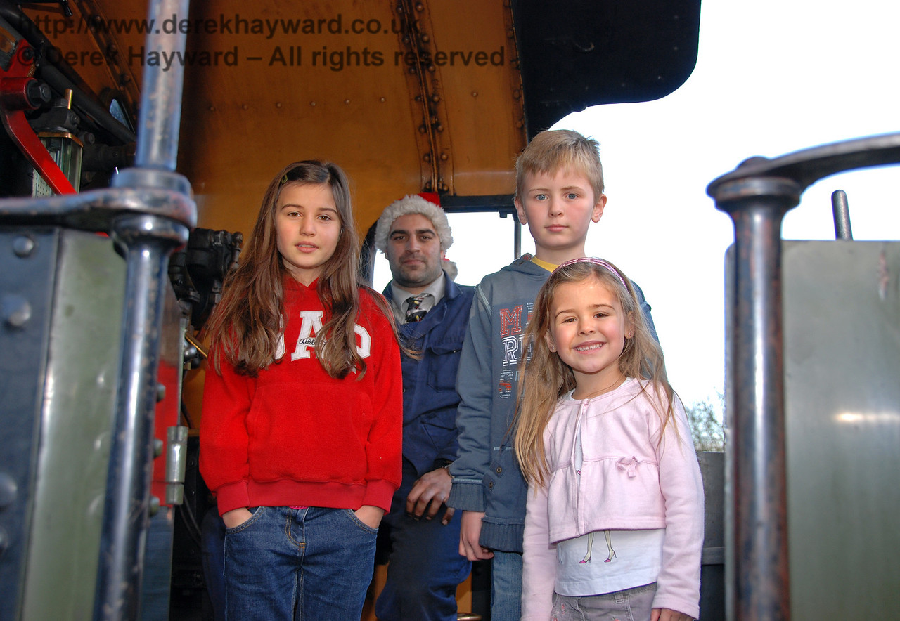 Happy visitors on the footplate of 1638. Kingscote 06.12.2009