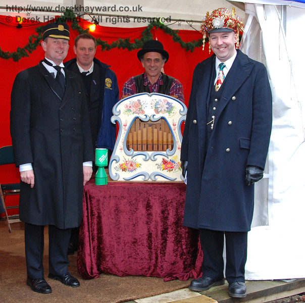 The organ grinder and.... some of the staff at Sheffield Park, of course. 13.12.2009