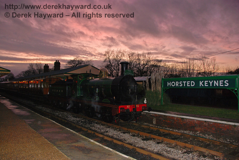 The last rays of the sun illuminate the sky as the dusk departure of the Victorian Christmas train stands at Horsted Keynes. 20.12.2008