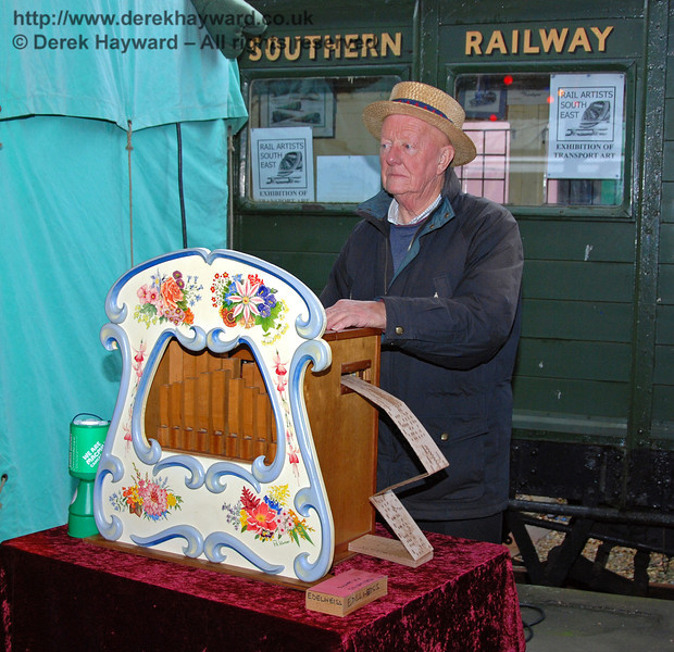 A gentleman busy providing the music at Horsted Keynes. 20.12.2008