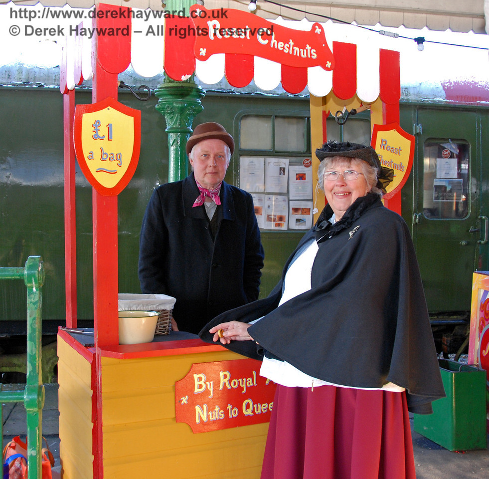 The nut vendor and a satisfied customer. Horsted Keynes. 02.01.2010