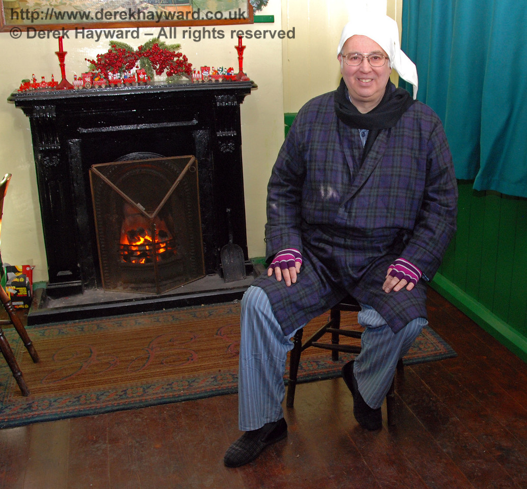 Scrooge keeps warm by the fire. Horsted Keynes 02.01.2010