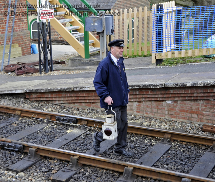 Armed with just a lamp Fraser starts the lonely walk south along the down line at Kingscote.  15.04.2012  4398   See next....