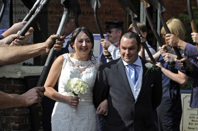 The happy couple pass through the Honour Guard.  Sheffield Park  15.09.2012  5680