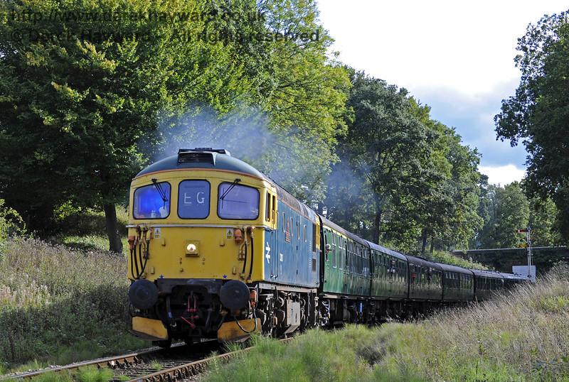 33103 Swordfish, covering a steam turn, pulls a service train north near Vaux End.  06.10.2013  8137
