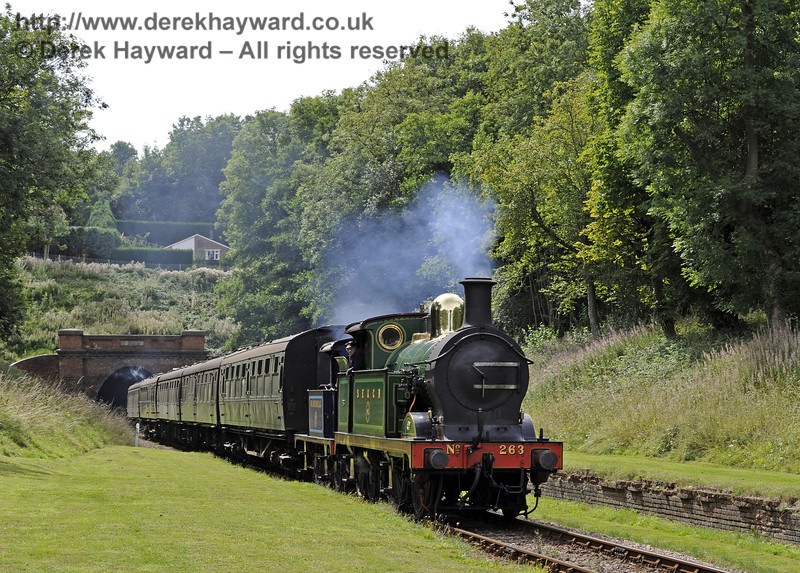 263 and 323 Bluebell emerge from West Hoathly tunnel with a northbound service train.  01.09.2013  7992