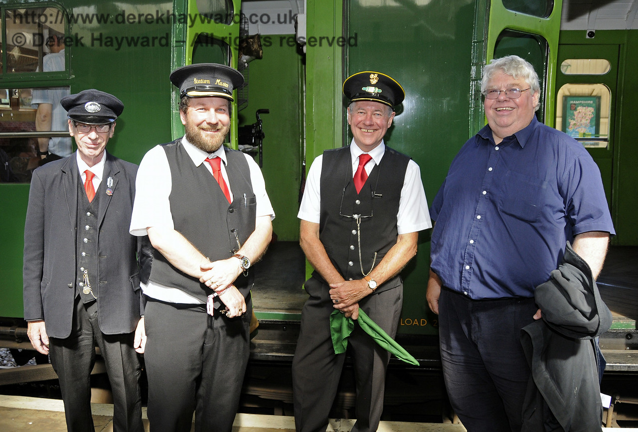 The station staff at Kingscote, the Guard of Tornado's service train, and Gavin Bennett, General Secretary BRPS pose for a photo whilst S&T were rectifying a minor fault with the token machine at the south signal box.  03.08.2014  11433