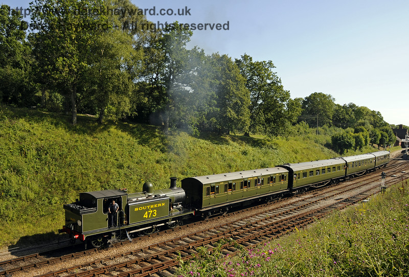 B473 has returned to service following repairs, and is seen leaving Horsted Keynes with the first public train that it has hauled for some time.  03.08.2014  11445