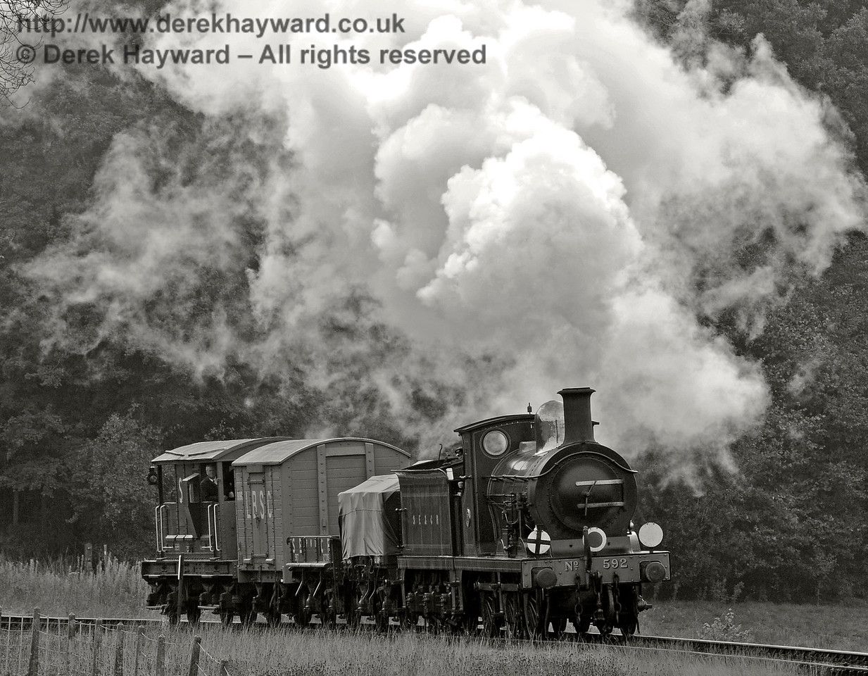 592 rounds the bend from Three Arch Bridge with a goods train.  10.10.2015  12119