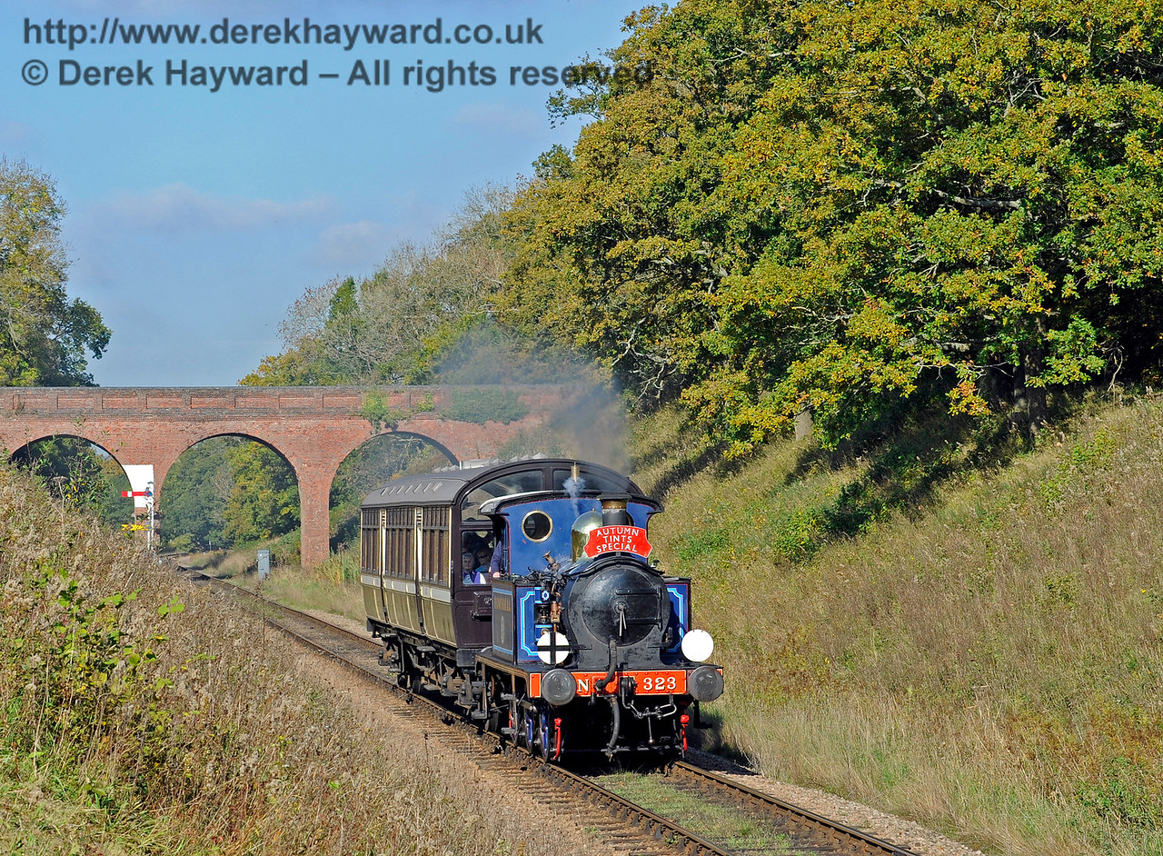 323 Bluebell steams south from Three Arch Bridge with an Autumn Tints train.  20.10.2015  12252