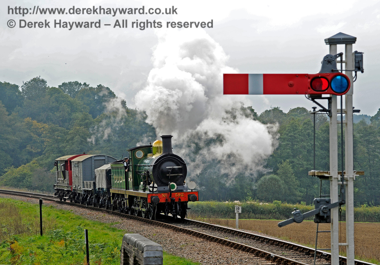 592 approaches New Road Bridge with a goods train.  10.10.2015  12130