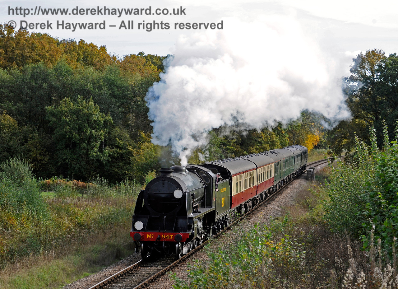 847 passes Medhurst Farm with a service train.  25.10.2015  12315