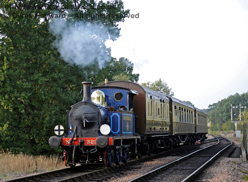 323 Bluebell crosses the River Ouse Bridge with the Pullman coaches.  04.10.2015   12107