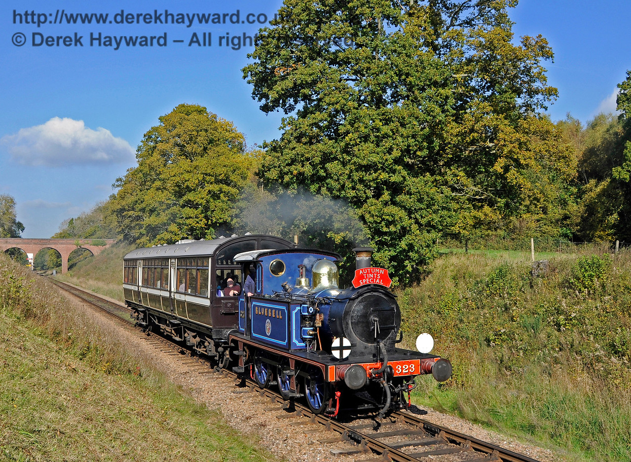 323 Bluebell steams south from Three Arch Bridge with an Autumn Tints train.  20.10.2015  13873