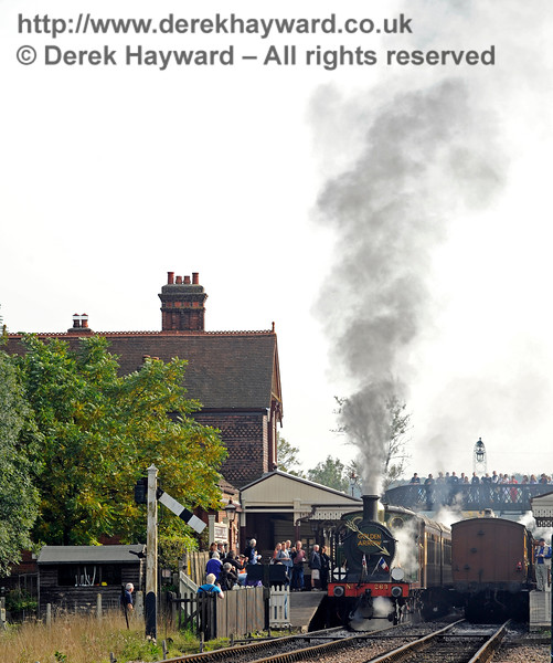 The platform and footbridge are crowded with people watching as 263 leaves Sheffield Park with the Golden Arrow.  04.10.2015   12037