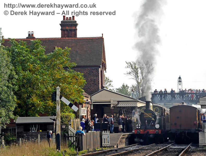 The platform and footbridge are crowded with people watching as 263 leaves Sheffield Park with the Golden Arrow.  04.10.2015   12036