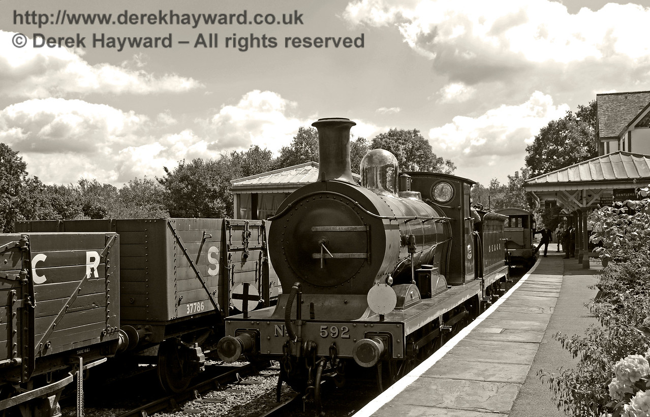 In the days of steam Pick Up Goods trains would regularly call at stations, and shunt the goods yard, adding and removing wagons from the train as required.  This rural scene is now lost.  06.08.2016 15893/BW