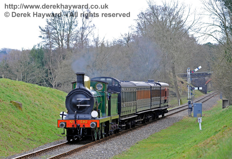 592 steams north from the Kingscote Up Home signals.  28.02.2016  12649