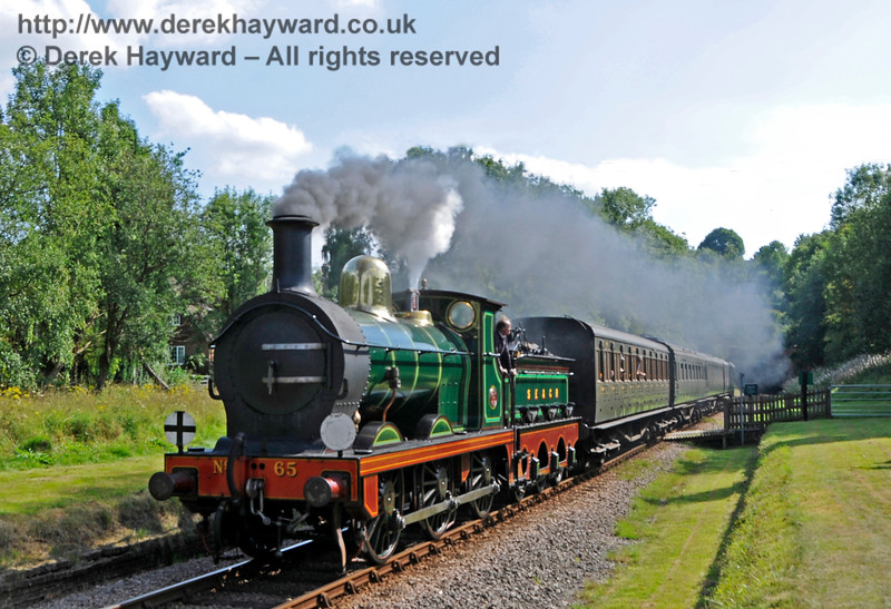 65 steaming north from West Hoathly Foot Crossing. 27.08.2017 17783