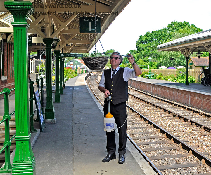Having assisted with the shunting, Fraser proved that he could multi-task by watering the hanging baskets.  01.06.2019 19203