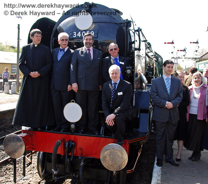 Father John Twisleton, Graham Flight, Viscount Thurso, Roger Cruse and Roy Watts pose on the front of 34059 Sir Archibald Sinclair. 24.04.2009  0126
