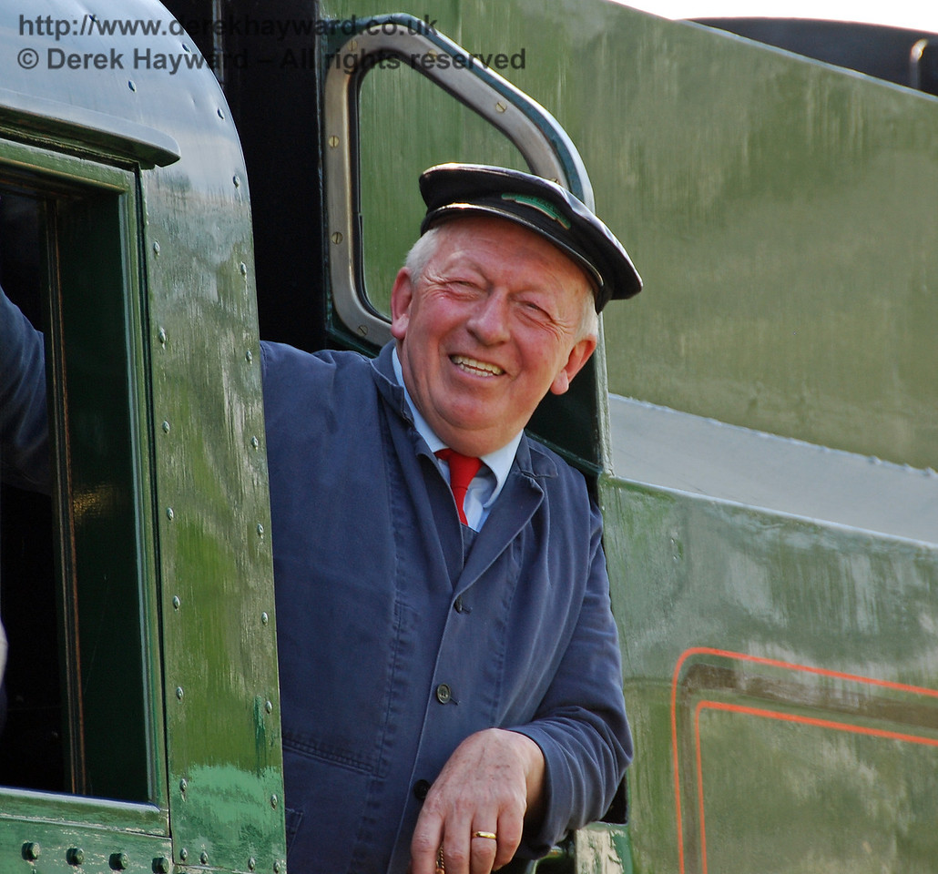 A member of the crew of 34059 Sir Archibald Sinclair enjoys the occasion. 24.04.2009  0077